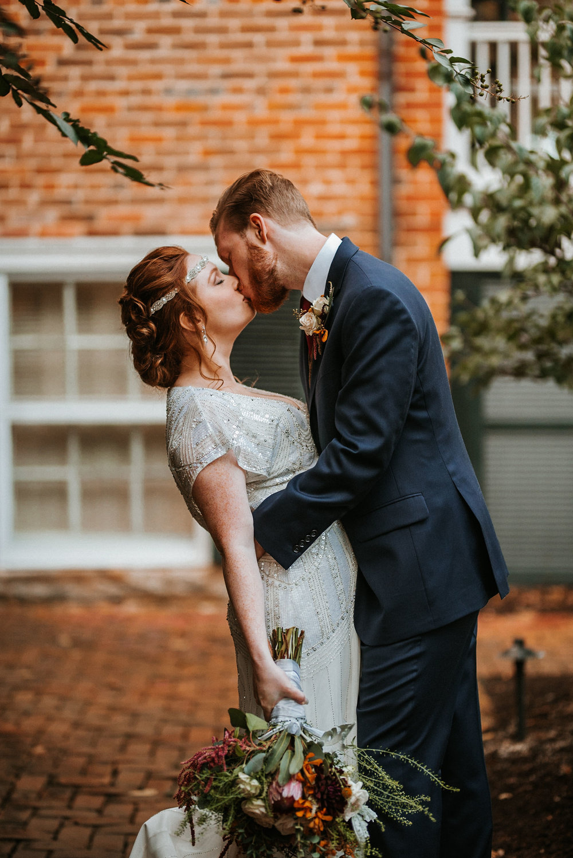 bride and groom kissing at Braehead Manor