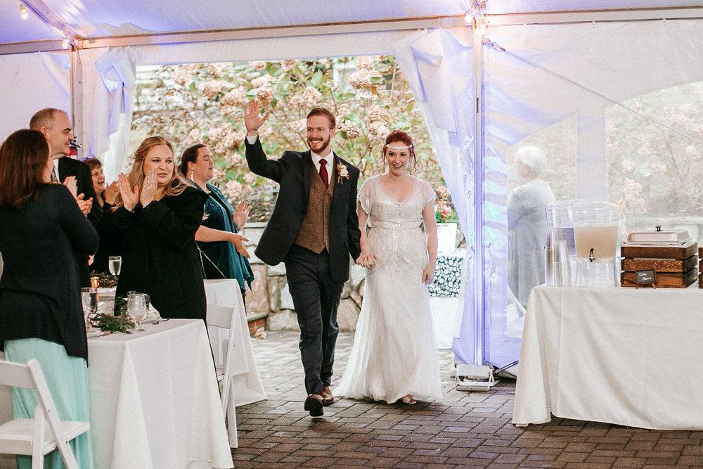 bride and groom enter the reception at Braehead Manor