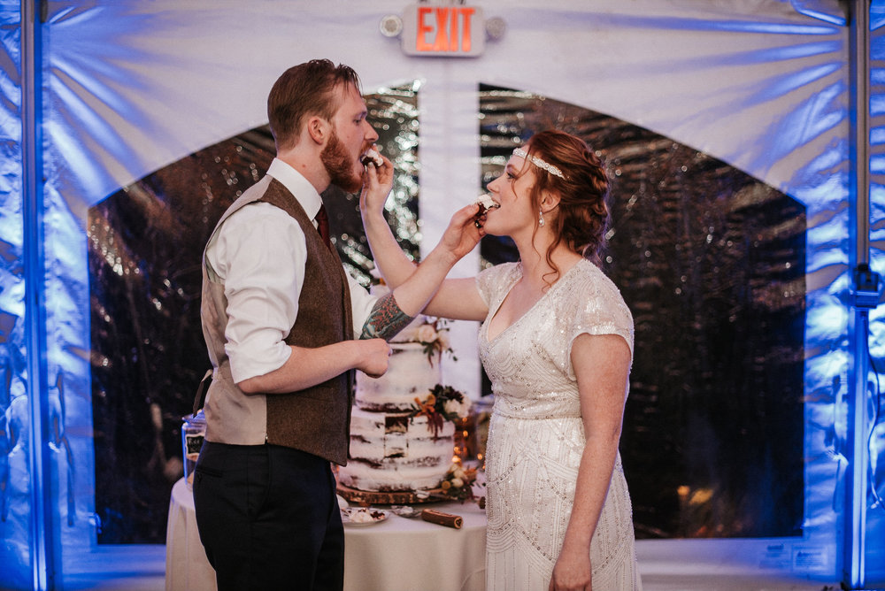 bride and groom eat wedding cake at Braehead Manor