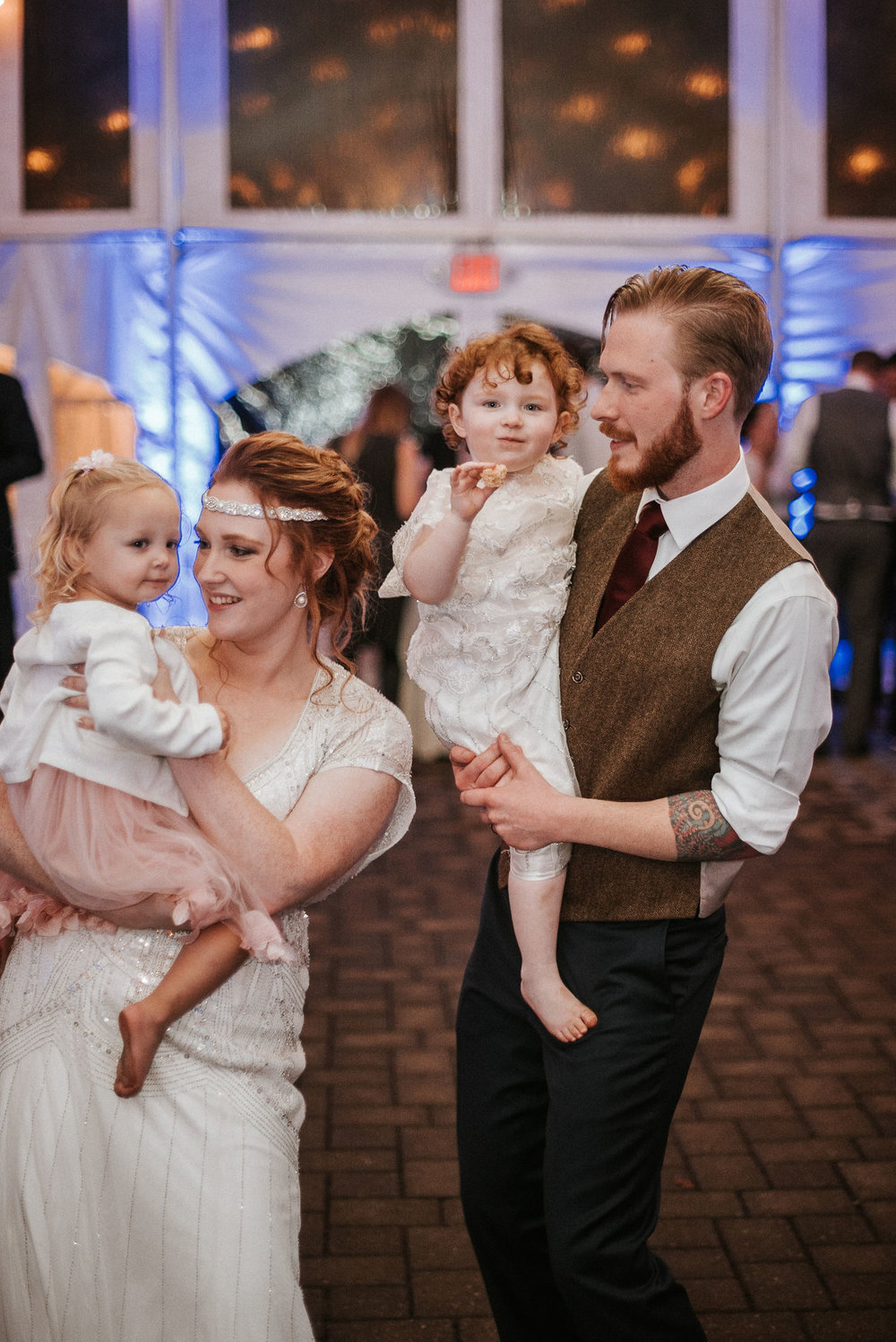 bride and groom dancing with children at Braehead Manor