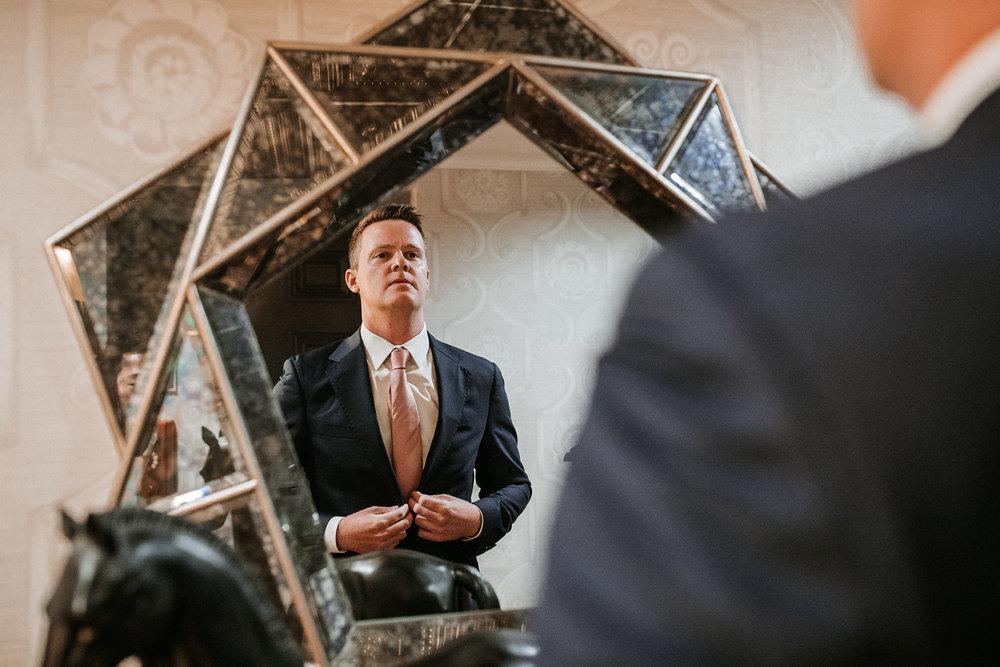 groom getting ready at Hotel Monaco