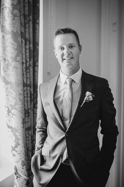groom smiling at Hotel Monaco