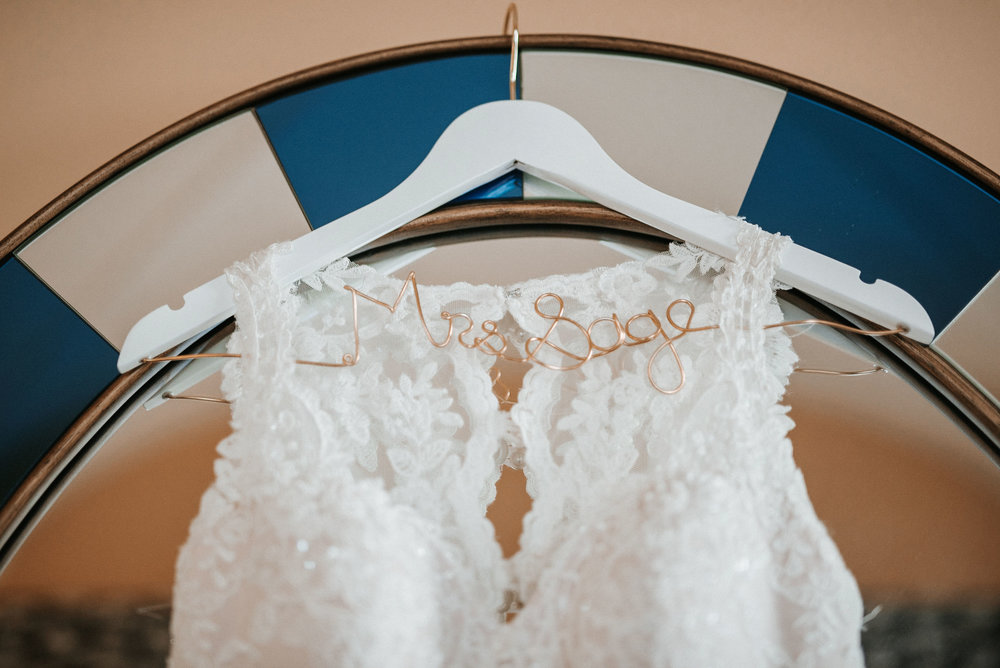 detail shot of bride's dress and hanger at Hotel Monaco
