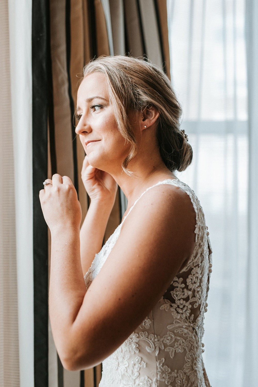 bride putting on earrings at Hotel Monaco