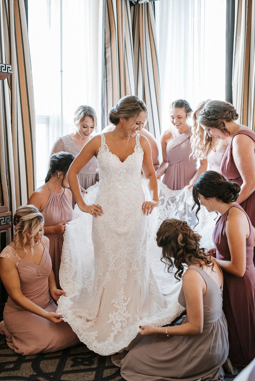 bridesmaids helping bride get ready at Hotel Monaco