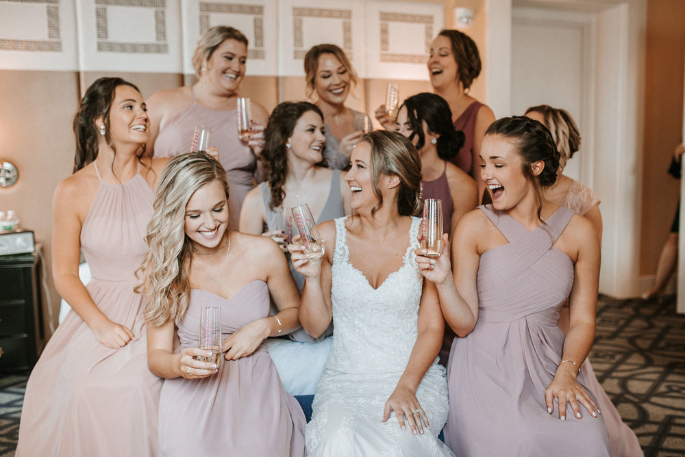 bride and bridesmaids drinking champagne at Hotel Monaco
