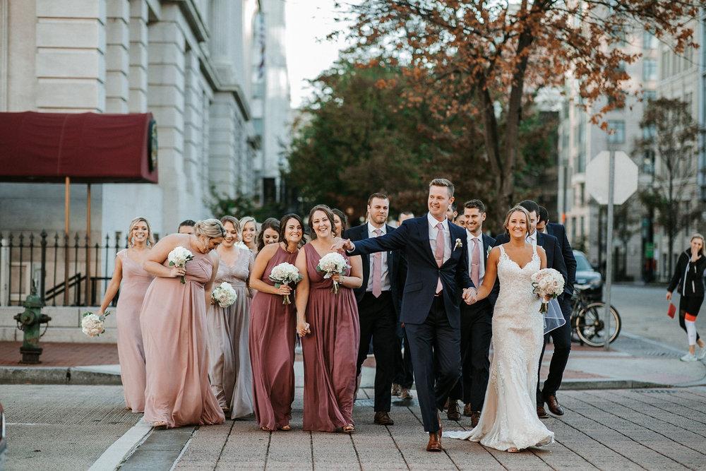 wedding party walking at Hotel Monaco