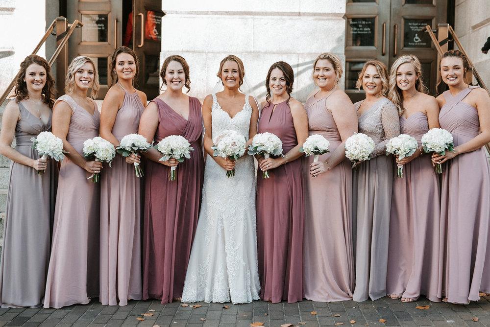 bride and bridesmaids smiling at Hotel Monaco