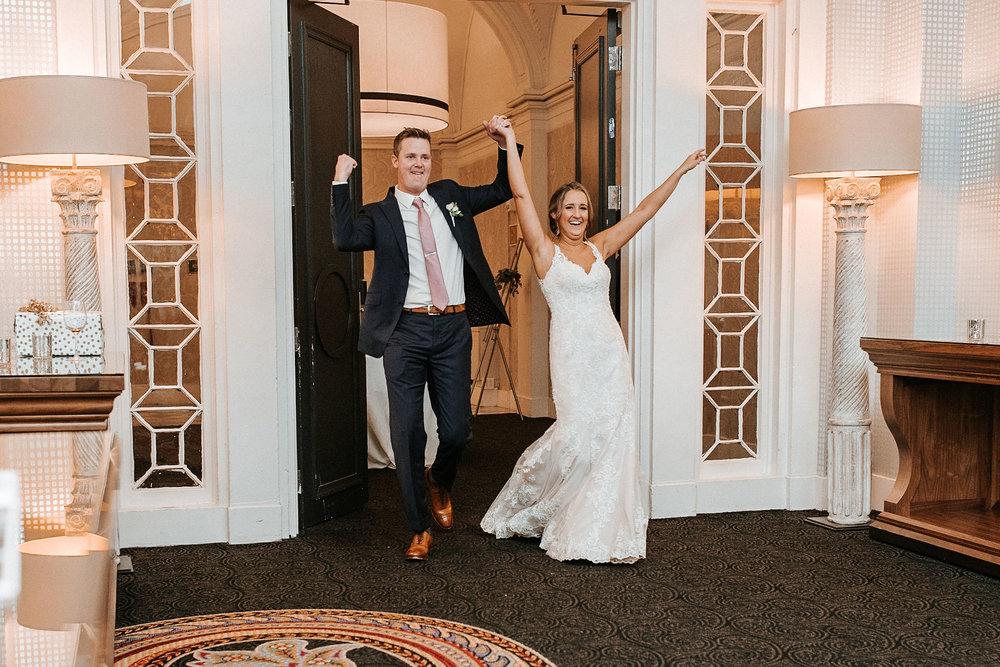 bride and groom entering reception at Hotel Monaco