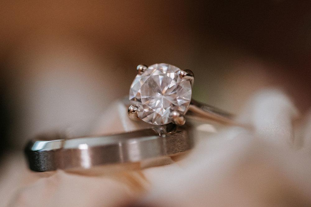 detail shot of wedding rings at the inn at the silk mill