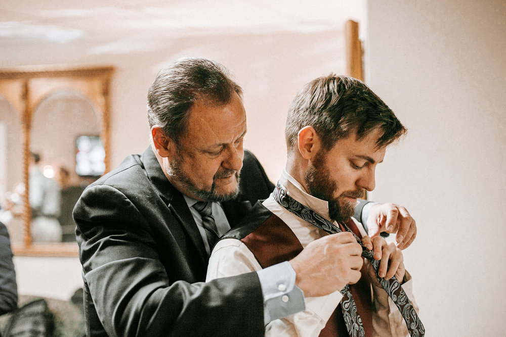 groom getting ready at the inn at the silk mill