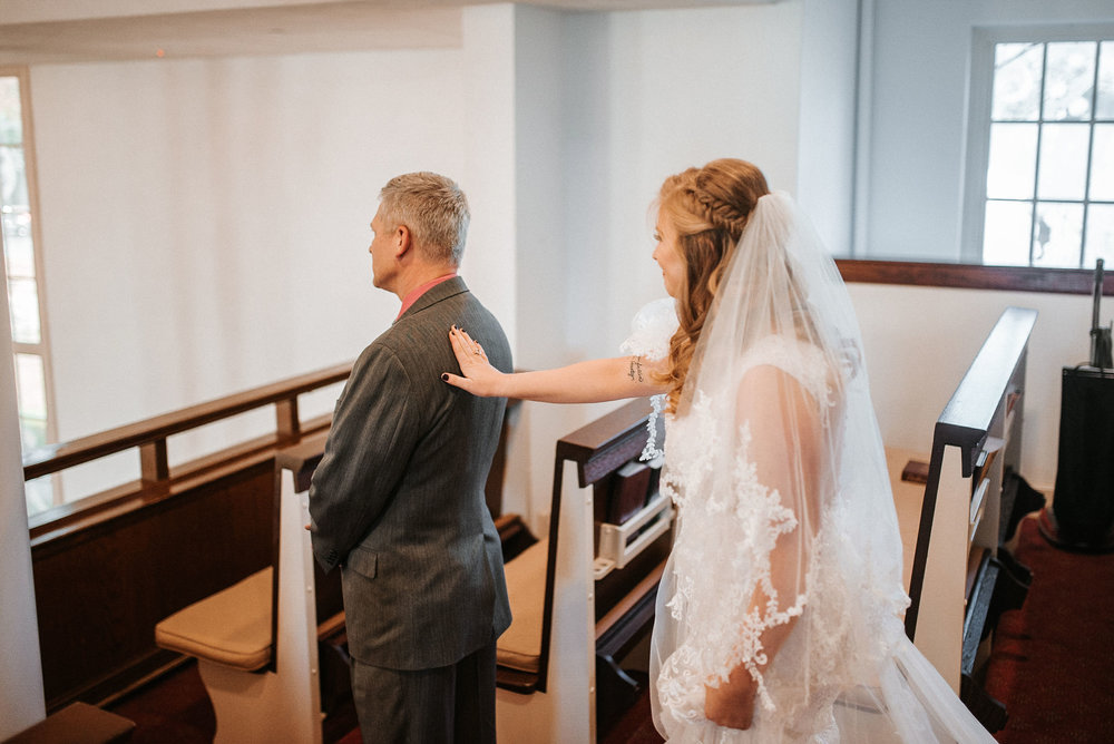 bride and father of the bride first look at the united states marine corps memorial chapel