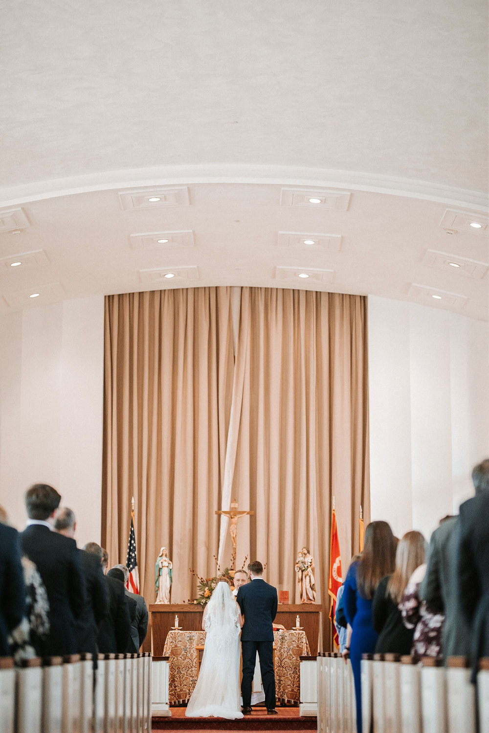 bride and groom holding hands at the united states marine corps memorial chapel