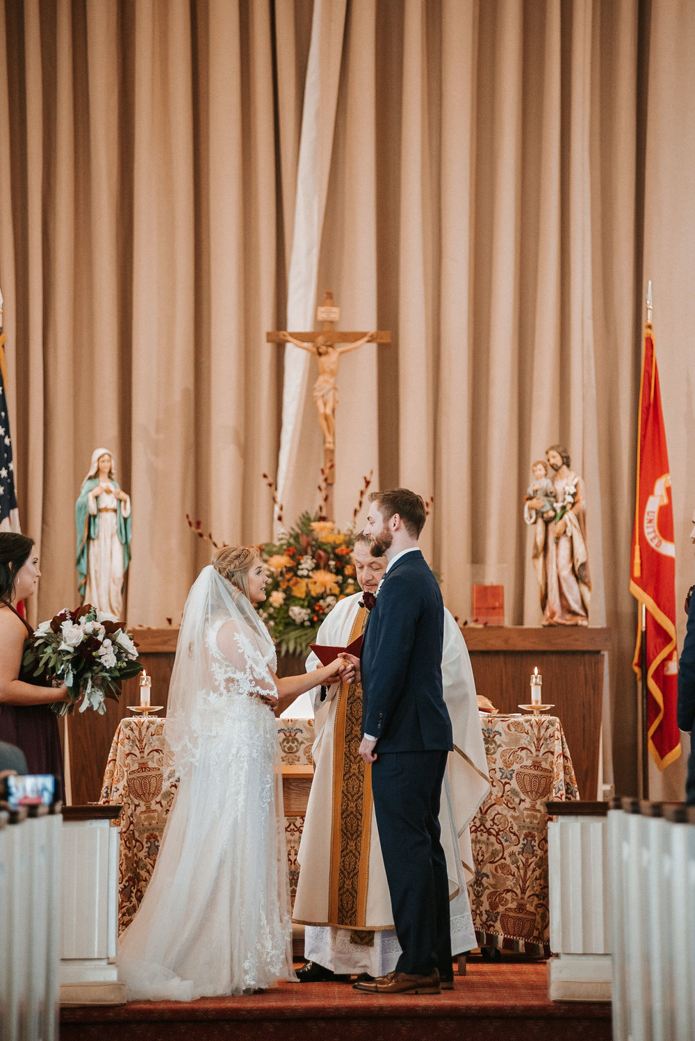 bride and groom exchanging vows at the united states marine corps memorial chapel