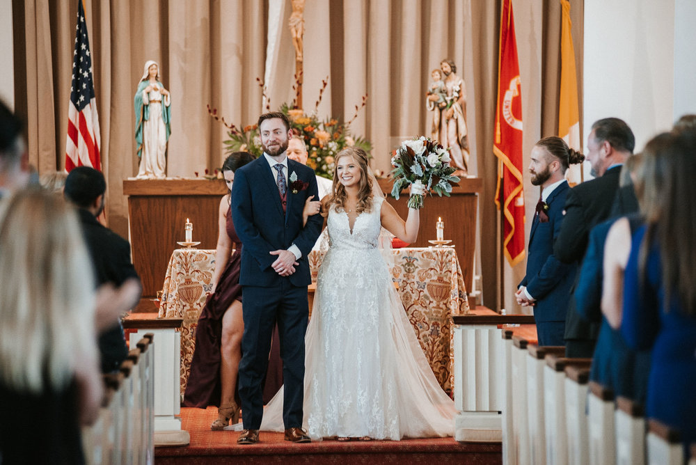 bride and groom after they said I do at the united states marine corps memorial chapel