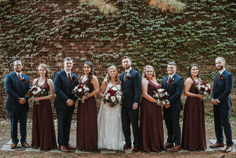 wedding party smiling at the inn at the silk mill
