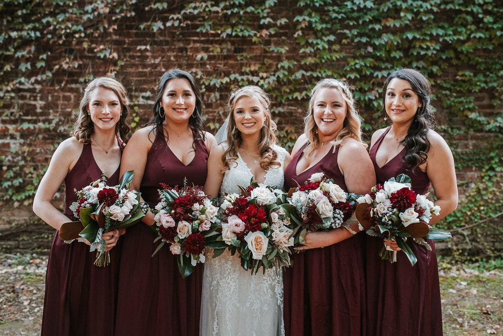 bridal party smiling at the inn at the silk mill