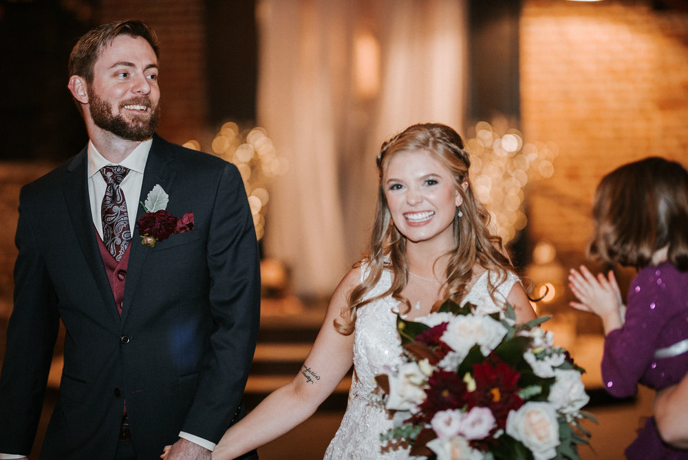 bride and groom smiling at the inn at the silk mill