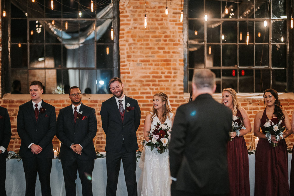 wedding party laughing at the inn at the silk mill