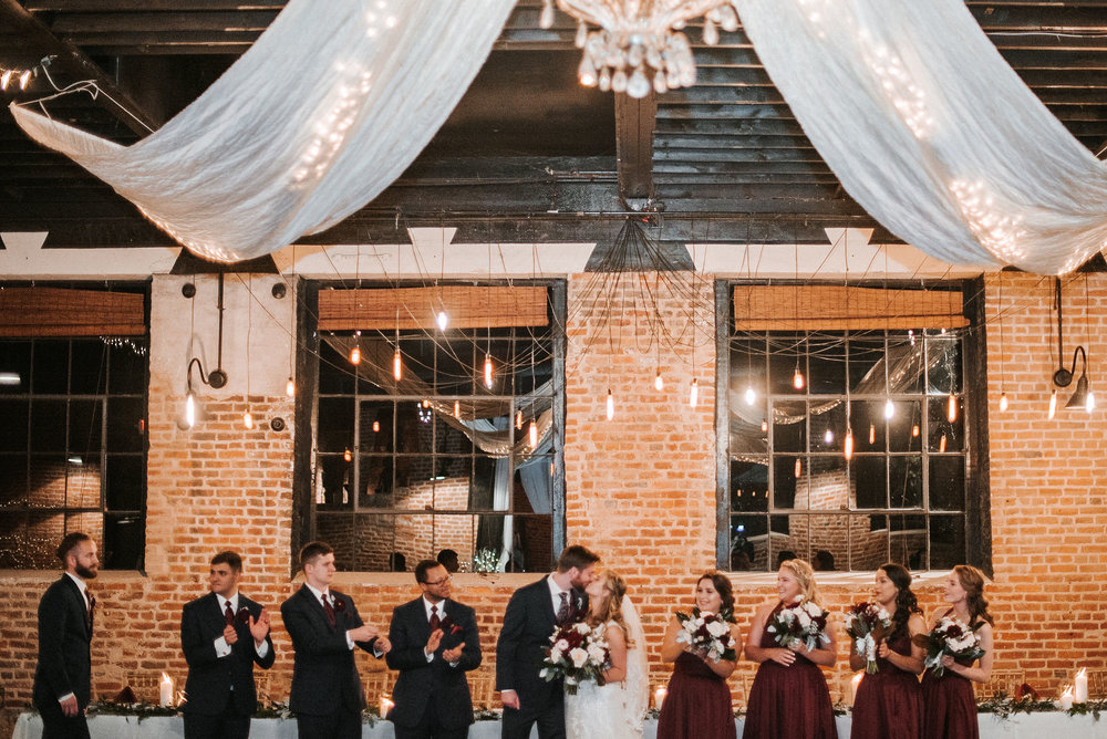 bride and groom kissing at the inn at the silk mill