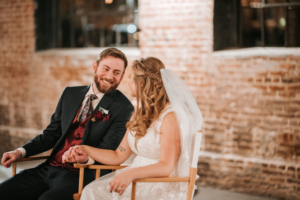 bride and groom laughing at the inn at the silk mill