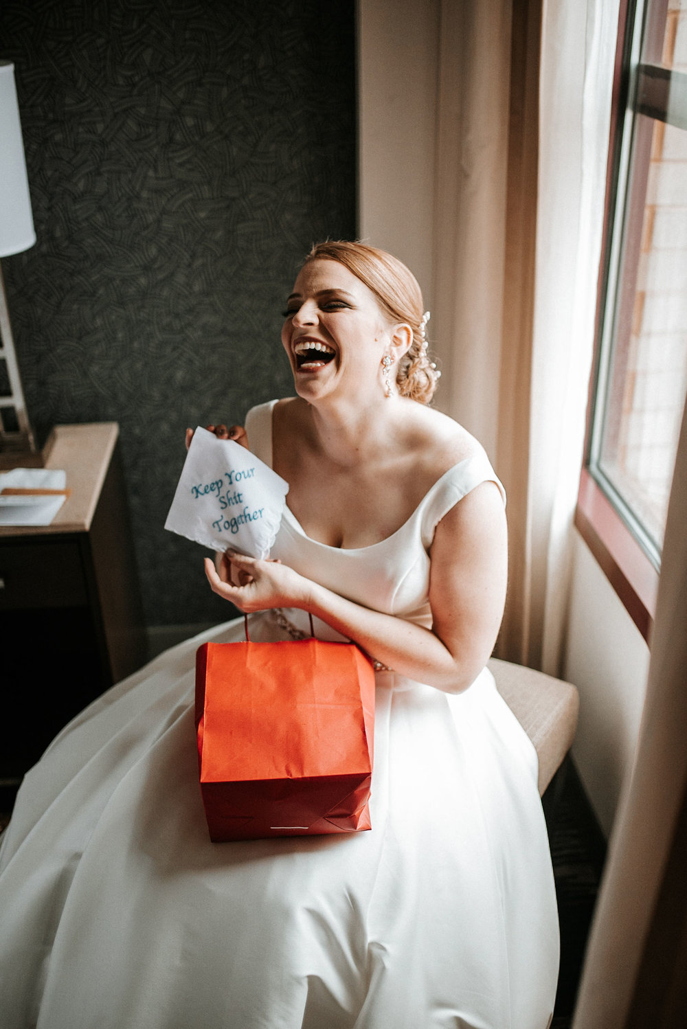bride opening gift from groom The George Washington Masonic National Memorial
