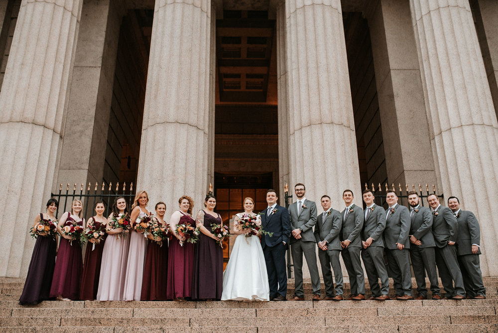wedding party smiling at The George Washington Masonic National Memorial