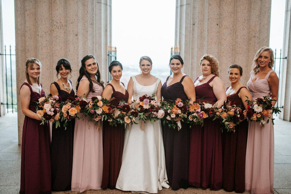 bridal party smiling at The George Washington Masonic National Memorial