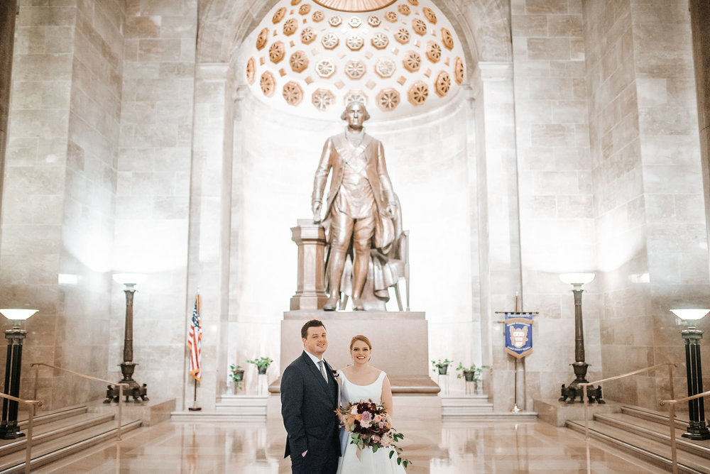 bride and groom smiling at The George Washington Masonic National Memorial