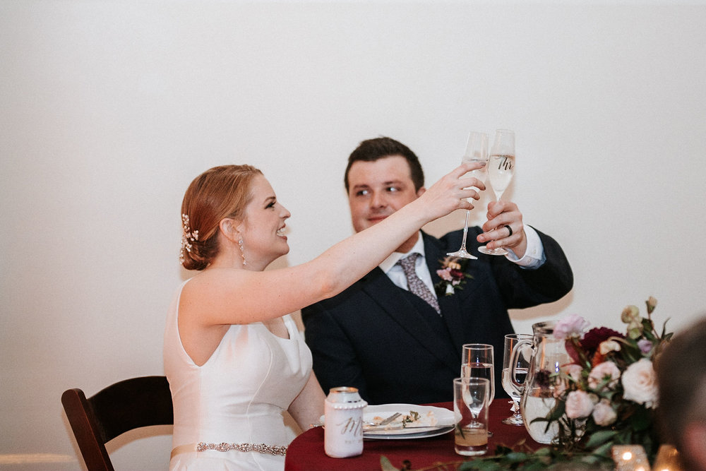 bride and groom cheering at The George Washington Masonic National Memorial
