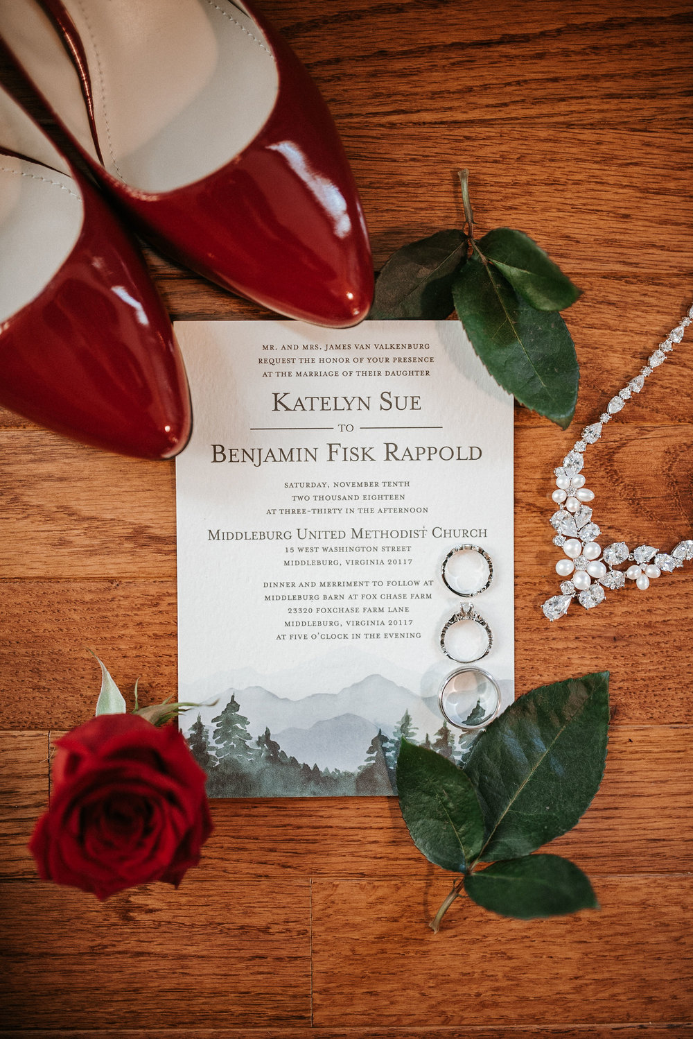 detail shot of bride's shoes and stationery at the middleburg barn at fox chase farm