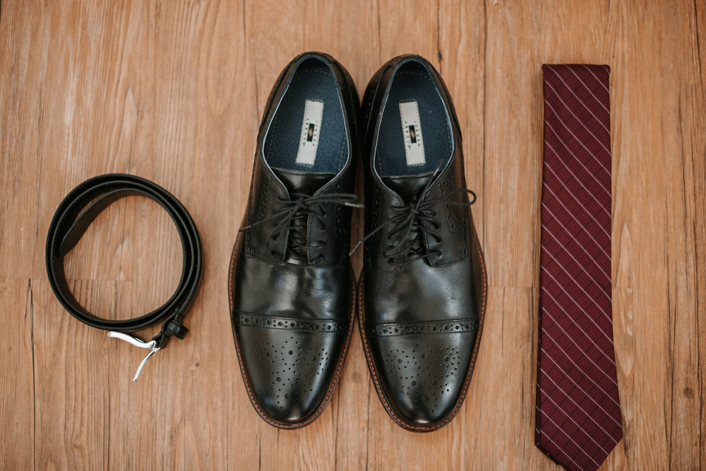 detail shot of groom's shoes and tie at the middleburg barn at fox chase farm
