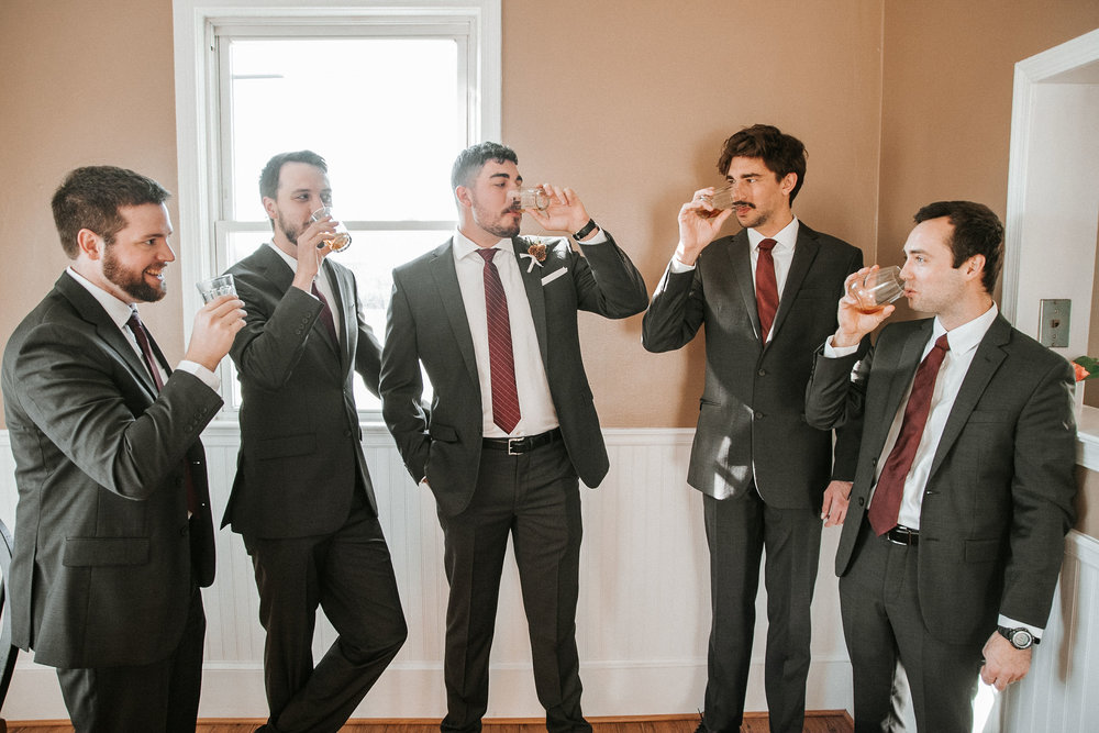 groom and groomsmen drinking at the middleburg barn at fox chase farm