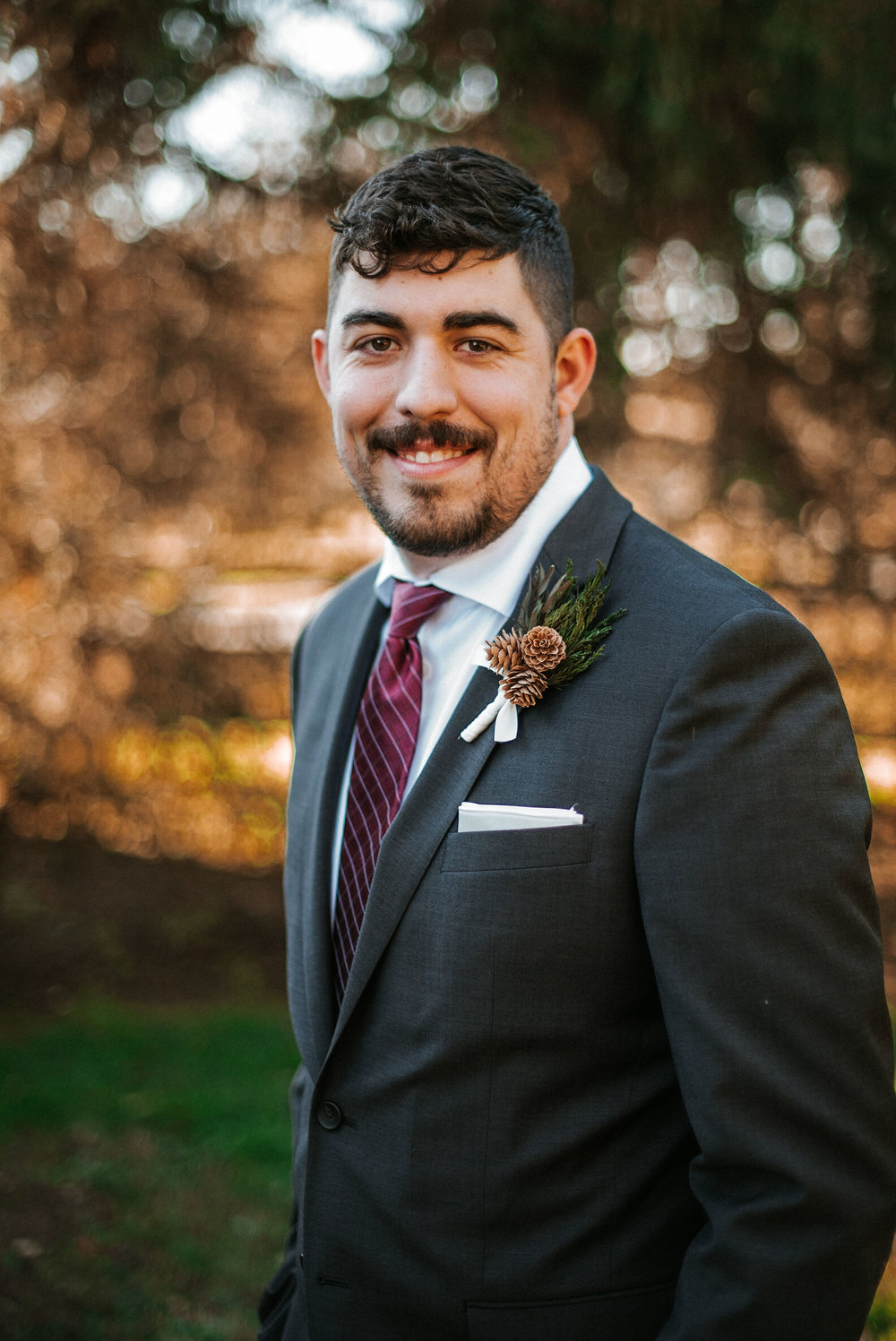 portrait of groom at the middleburg barn at fox chase farm