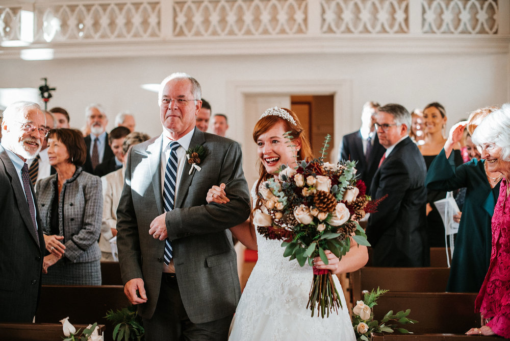bride walking down the aisle at the Middleburg United Methodist Church