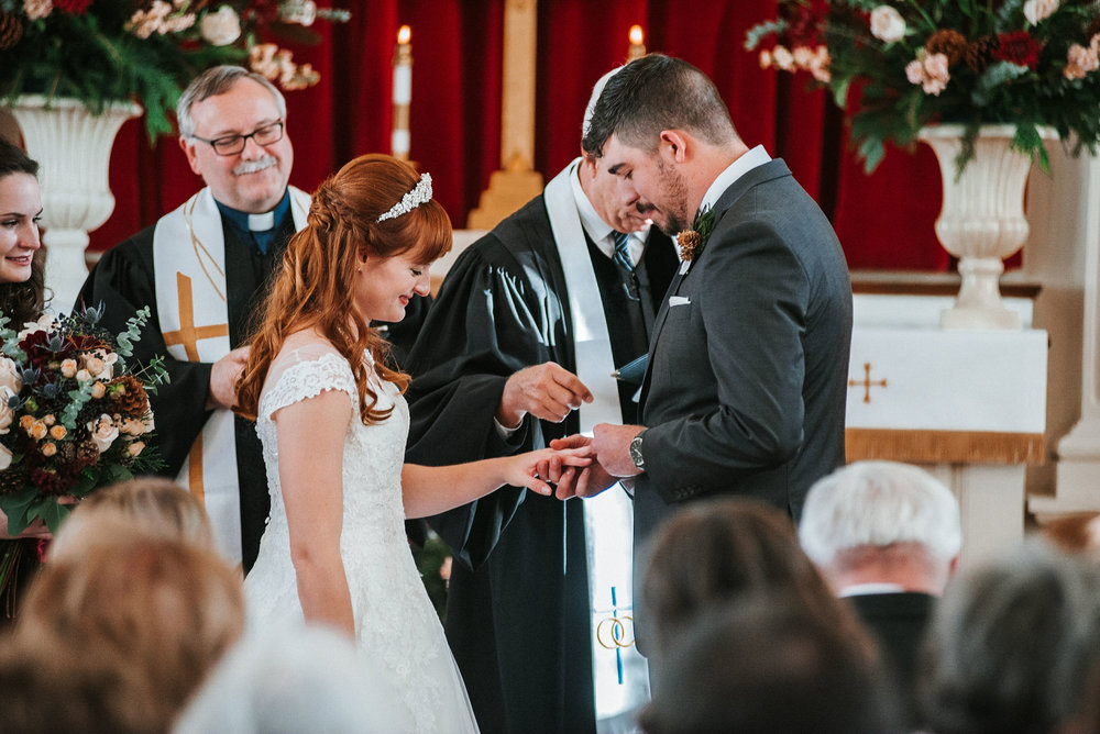 bride and groom exchanging rings at the Middleburg United Methodist Church