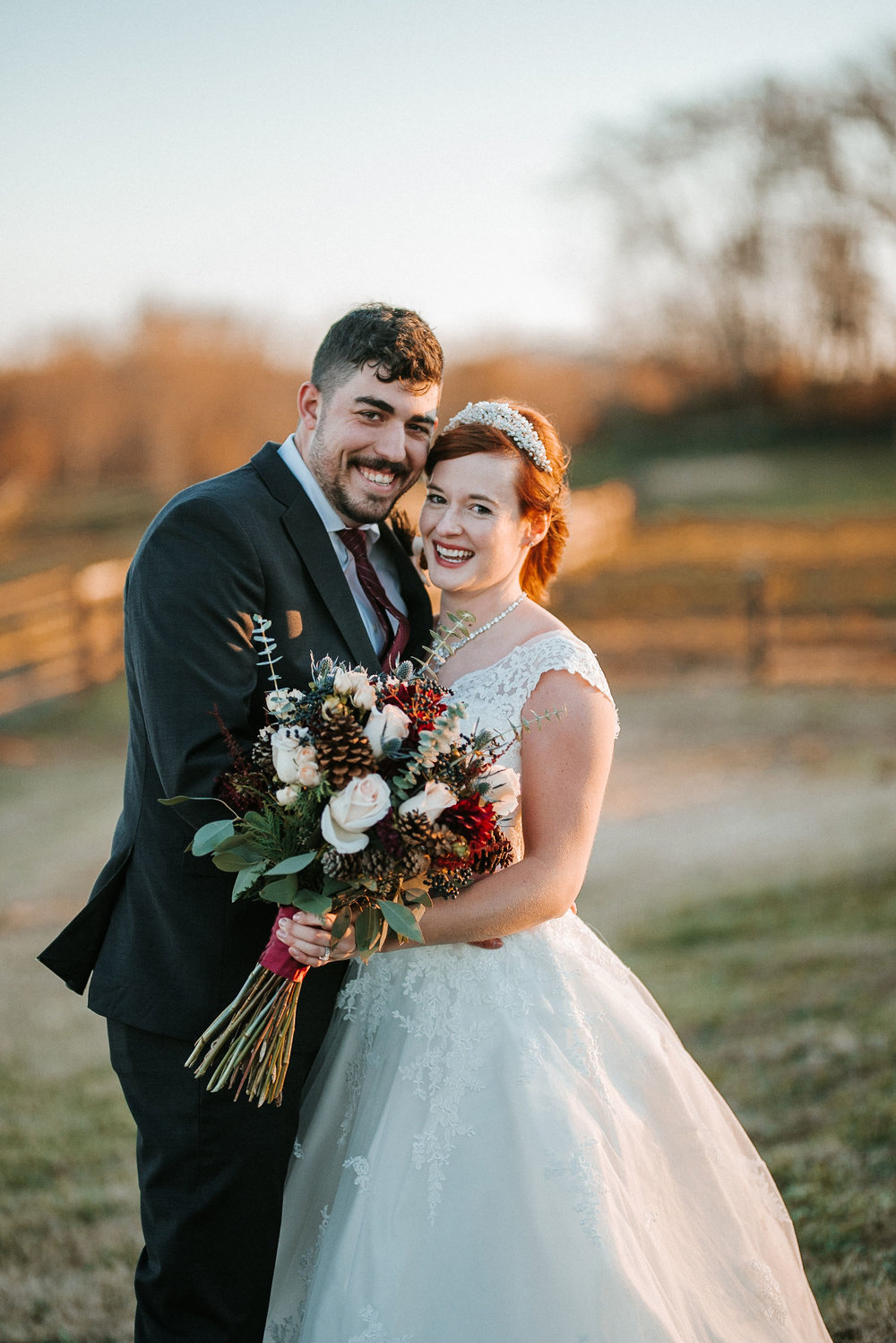 bride and groom smiling at The Middleburg Barn at Fox Chase Farm