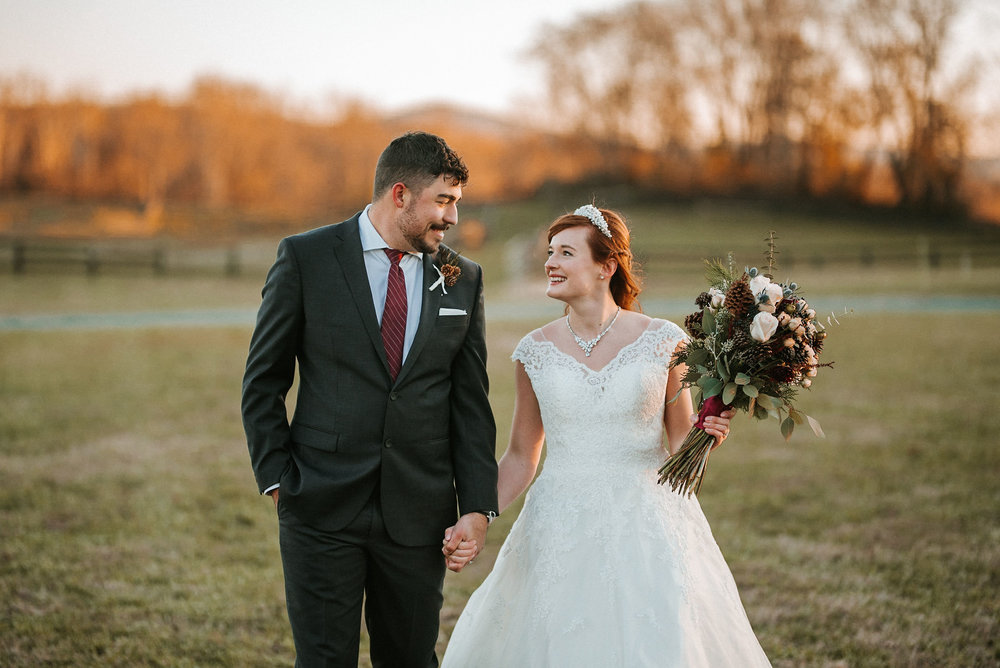 bride and groom holding hands at The Middleburg Barn at Fox Chase Farm