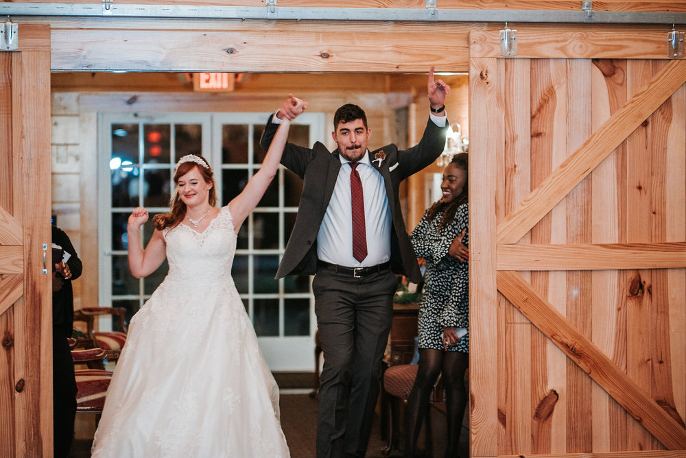 bride and groom entering reception at The Middleburg Barn at Fox Chase Farm