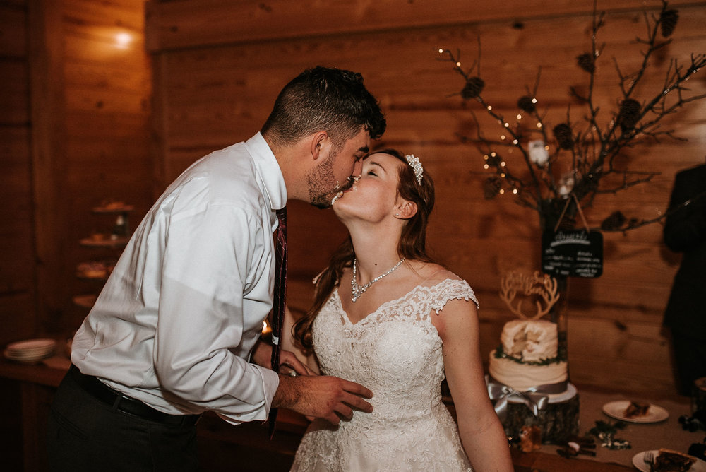 bride and groom kissing at The Middleburg Barn at Fox Chase Farm