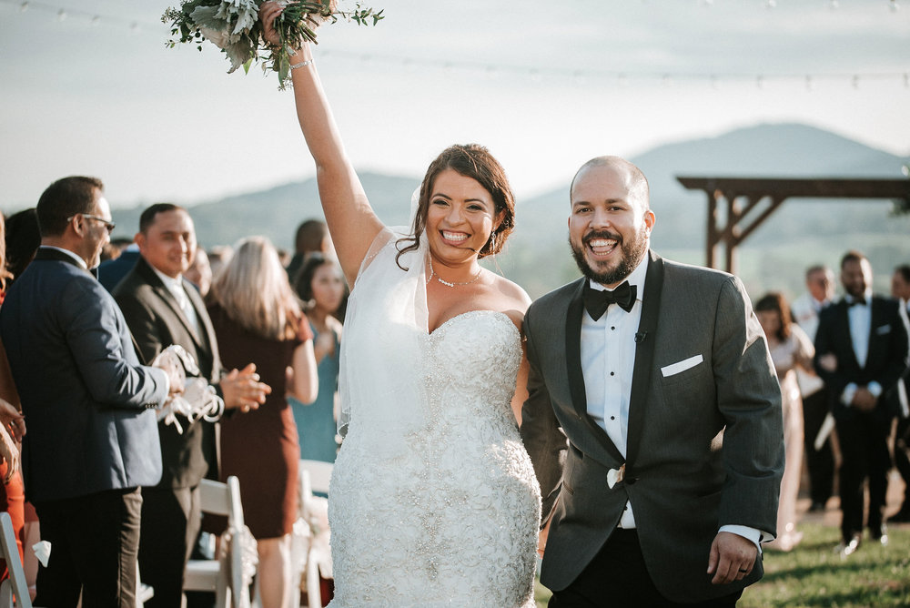bride and groom smiling after ceremony