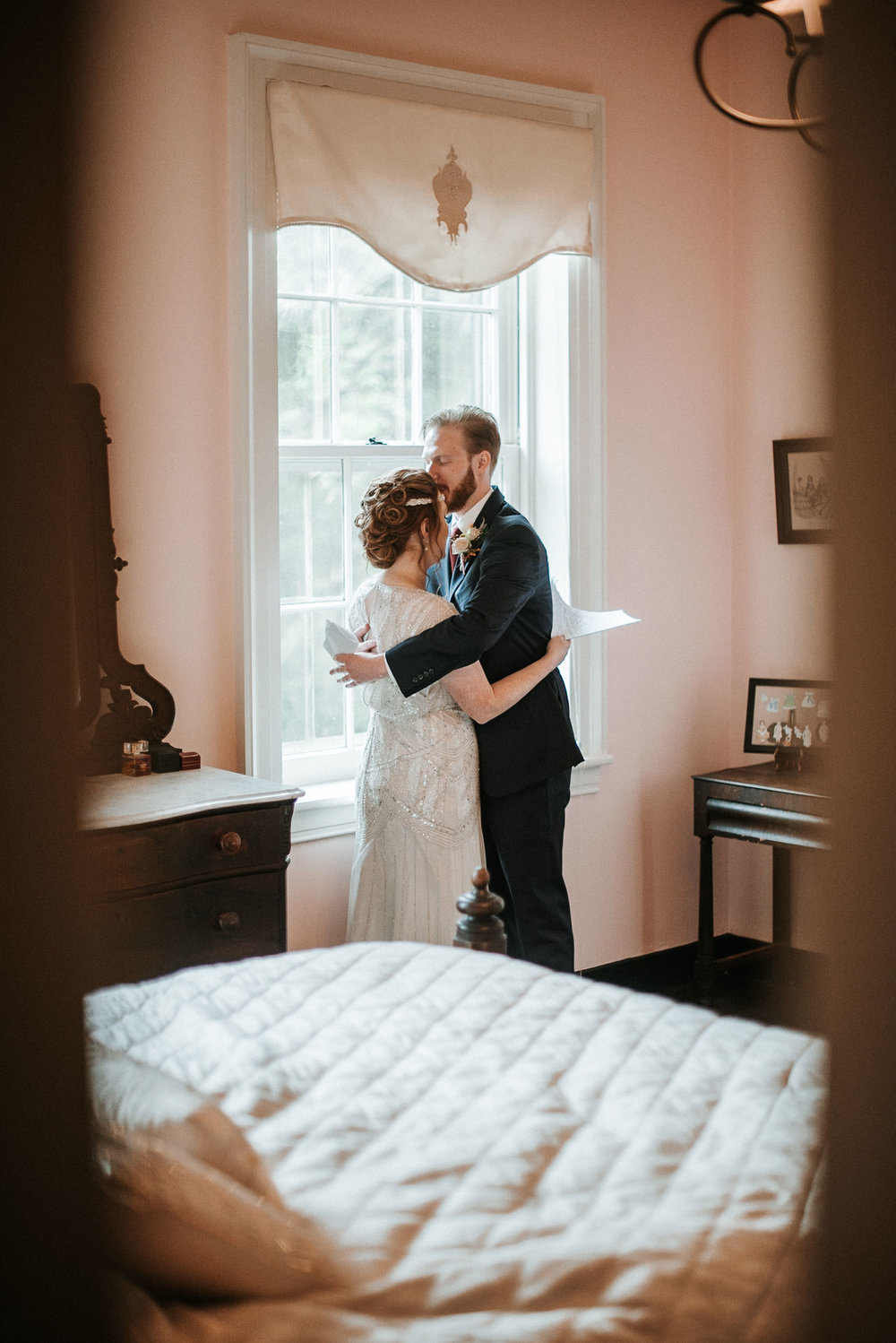 bride and groom embracing after reading letters to each other