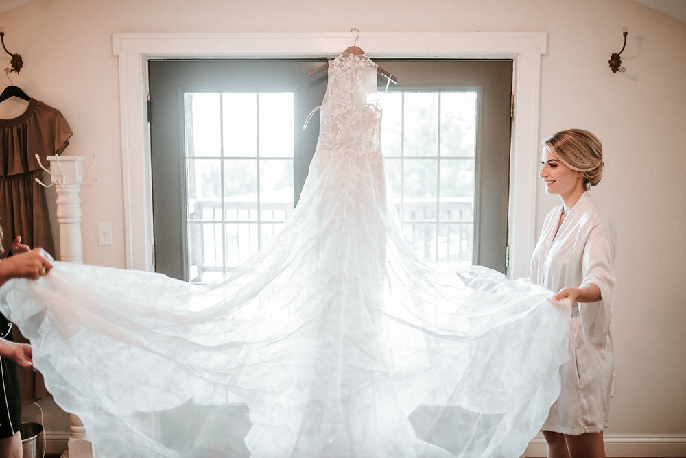 Bride admiring her wedding dress at Bluemont, Virginia