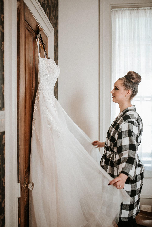 Bride looking at wedding dress at Whitehall Estate
