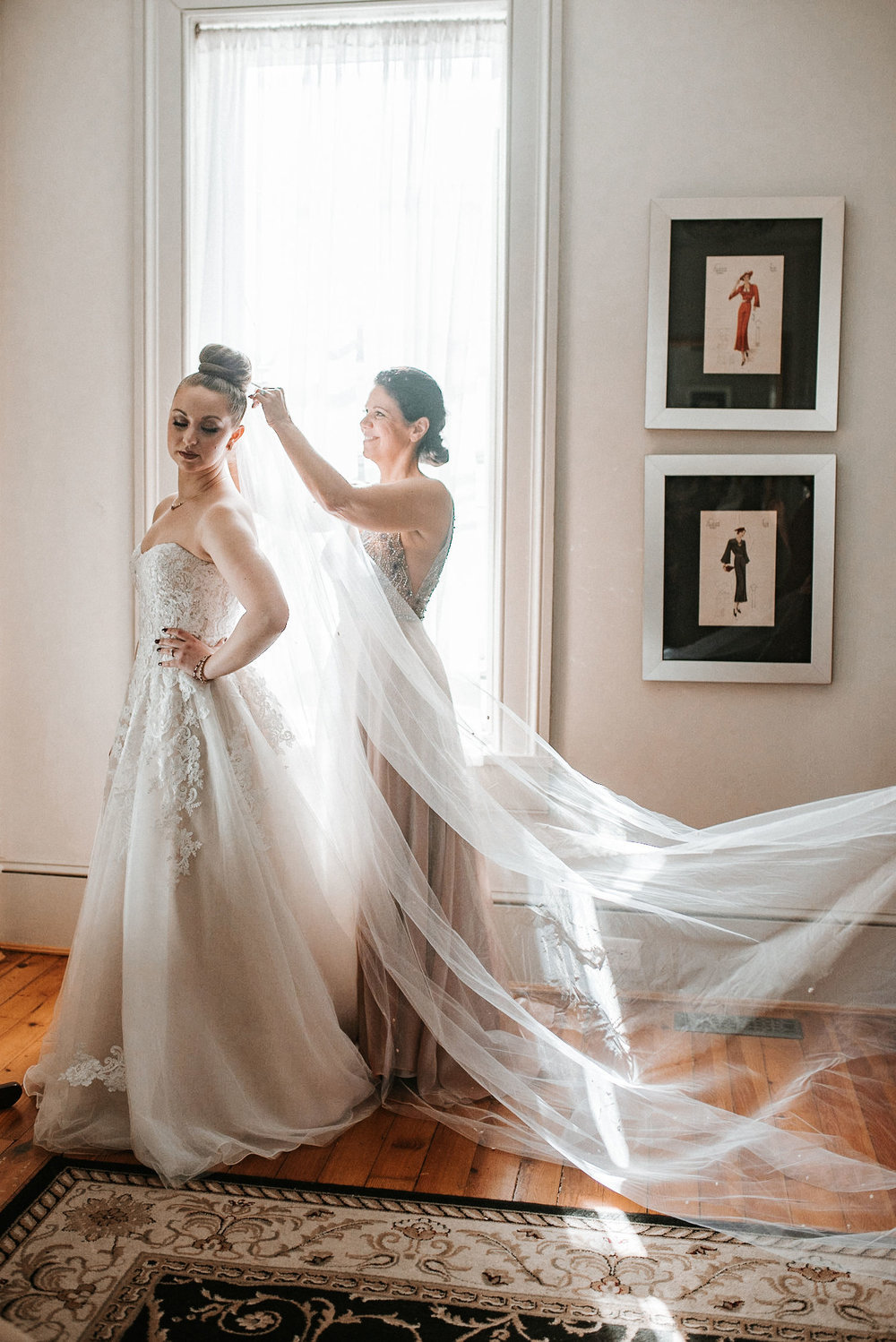 mother of the bride putting veil on bride at Whitehall Estate