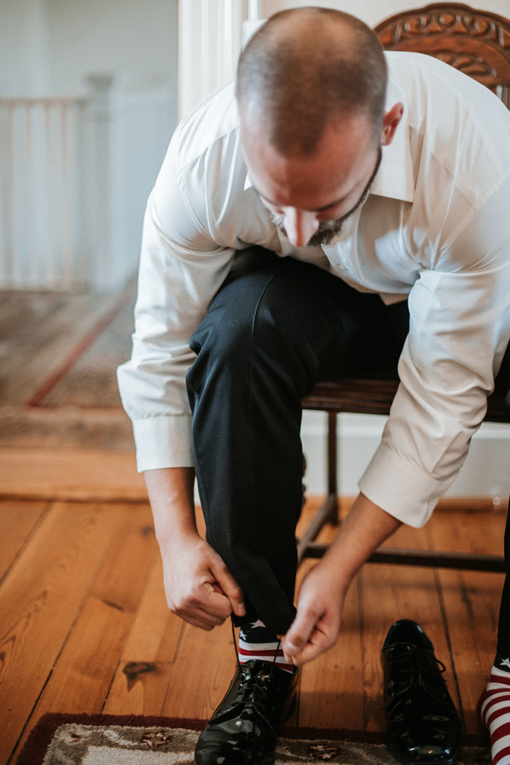 groom putting on shoes at Whitehall Estate