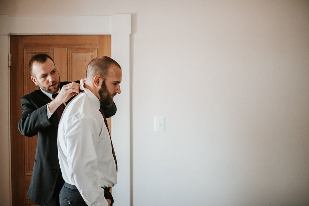 groom getting ready at Whitehall Estate