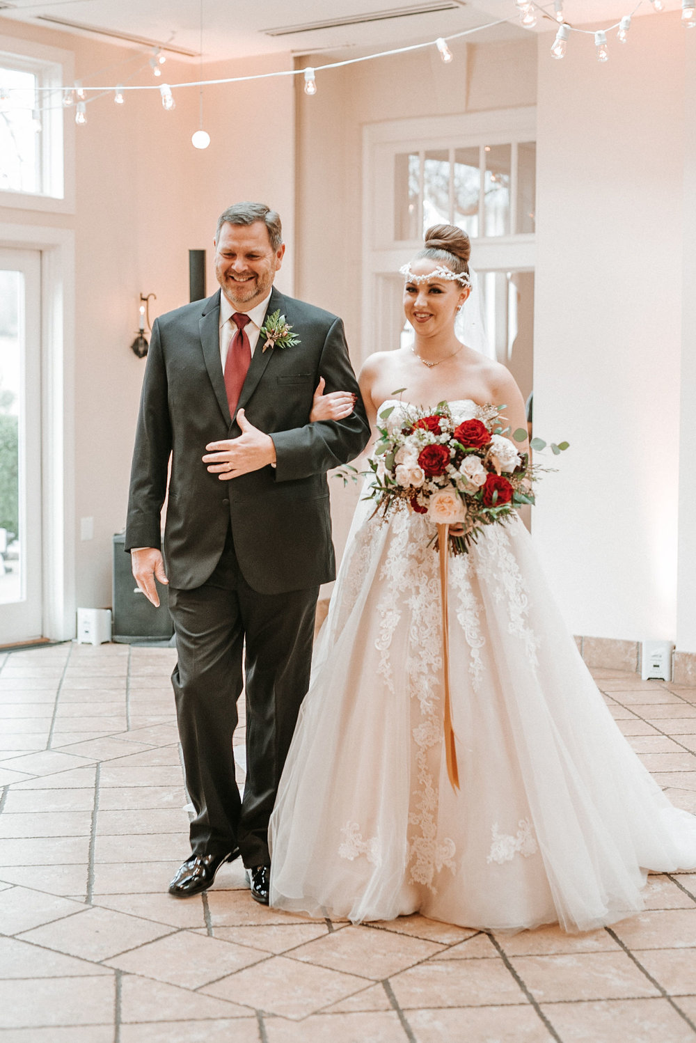 bride and father of the bride walking down the aisle at Whitehall Estate