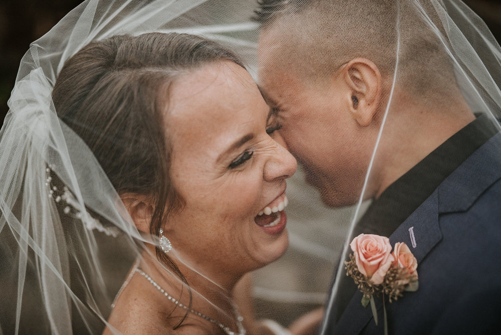 Couple Laughing on their Wedding Day