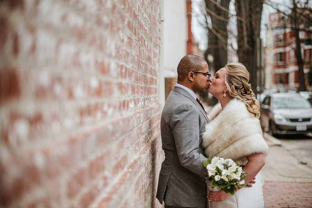bride and groom kissing at the josephine butler parks center